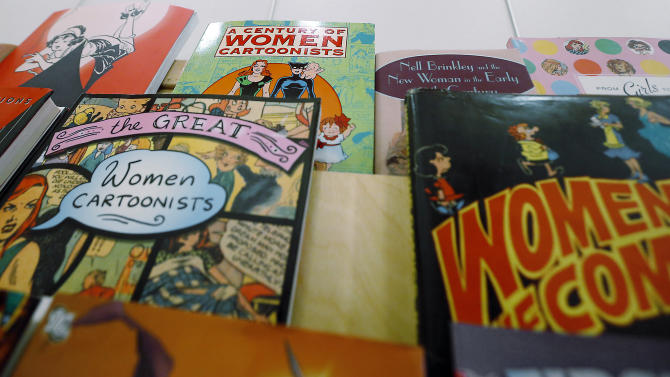 In this photo made on Wednesday, Feb. 5, 2014, a display of books about women cartoonists and female characters in cartoons is part of an exhibit at the Toonseum in Pittsburgh that documents female comic artists over the last 70 years. (AP Photo/Keith Srakocic)