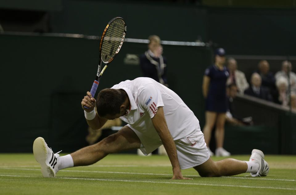 Viktor Troicki of Serbia reacts during a fourth round singles match against Novak Djokovic of Serbia at the All England Lawn Tennis Championships at Wimbledon, England, Monday, July 2, 2012. (AP Photo/Anja Niedringhaus)