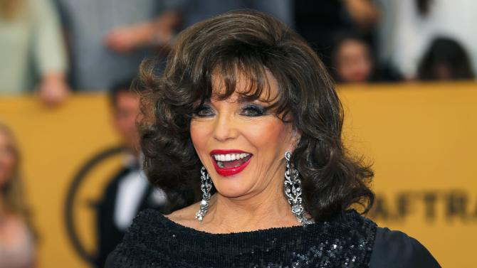 Actress Joan Collins arrives at the 21st annual Screen Actors Guild Awards in Los Angeles