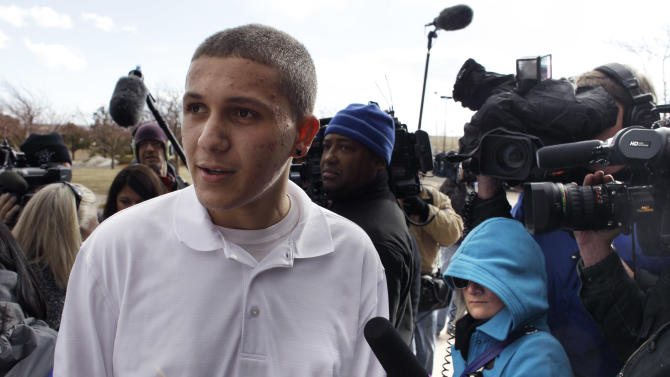 Yousef Gharbi, who was wounded when he was shot in the head in the Aurora movie theater shooting, speaks with members of the media following a court proceeding for Aurora theater shooting suspect James Holmes at the courthouse in Centennial, Colo., on Friday, Jan. 11, 2013.  Holmes arraignment hearing was postponed to March 12. (AP Photo/Brennan Linsley)