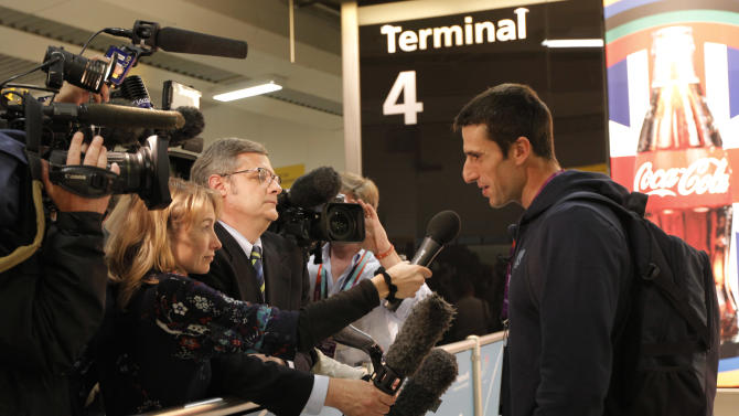 French Olympic canoeist Tony Estanguet talks to the media after arriving at Heathrow Airport Monday, July 16, 2012, as competitors arrive in London during preparations for the upcoming London 2012 Olympic Games.  (AP Photo/Charlie Riedel)