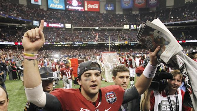 Alabama's AJ McCarron celebrates after the BCS National Championship college football game against LSU Monday, Jan. 9, 2012, in New Orleans. Alabama won 21-0. (AP Photo/Dave Martin)