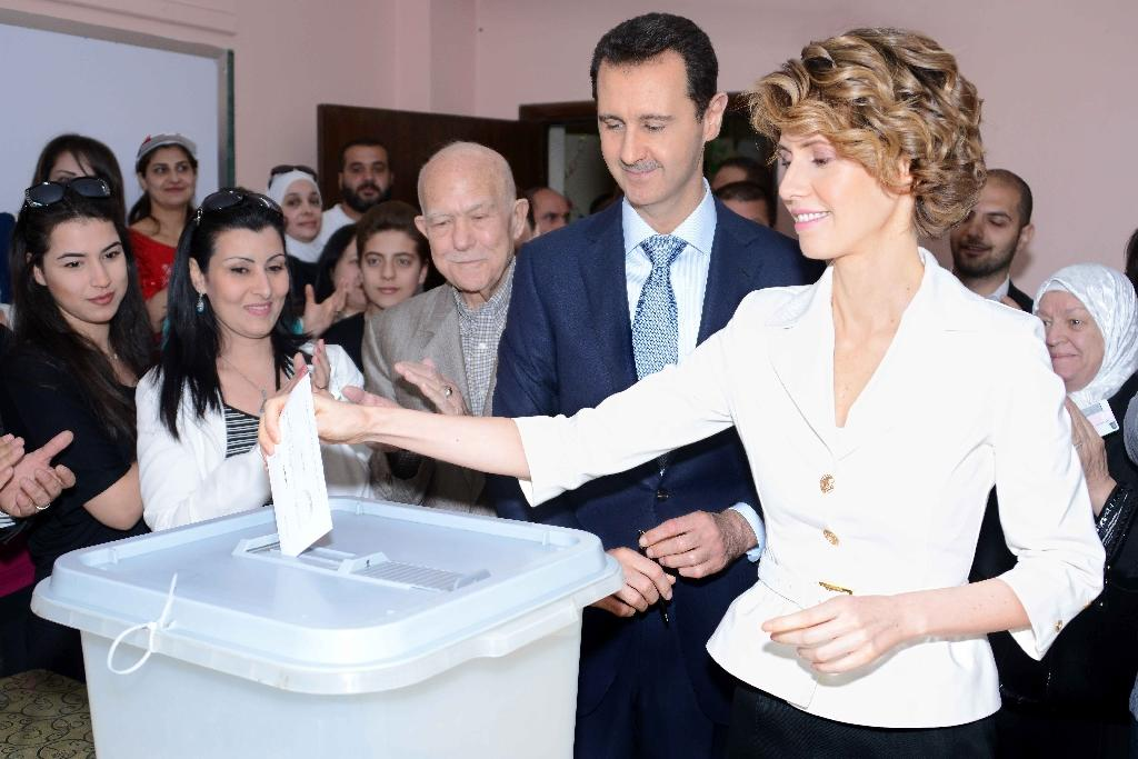 Putin says Assad agrees to early parliamentary polls
