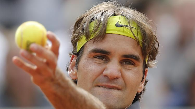 Roger Federer of Switzerland prepares to serve in his quarter final match against Juan Martin del Potro of Argentina at the French Open tennis tournament in Roland Garros stadium in Paris, Tuesday June 5, 2012. (AP Photo/Christophe Ena)