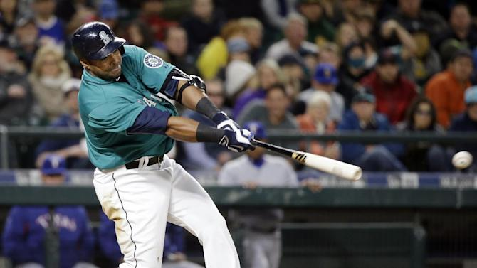 Seattle Mariners' Nelson Cruz singles against the Texas Rangers during the fourth inning of a baseball game Friday, April 17, 2015, in Seattle. (AP Photo/Elaine Thompson)