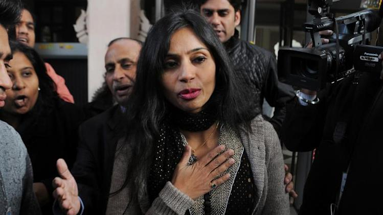 Indian diplomat Devyani Khobragade leaves her guest house to meet with Salman Khurshid, Indian Minister for External Affairs, in New Delhi on January 11, 2014