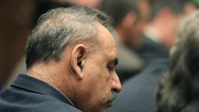 Oscar Hernandez, former mayor of Bell, Calif.  listens to the judge as a guilty verdict is read in his trial on Wednesday, March 20, 2013, in Los Angeles.  Hernandez and four former elected officials were convicted of multiple counts of misappropriation of public funds, and a sixth defendant was cleared entirely. Hernandez and co-defendants George Cole, Teresa Jacobo, George Mirabal,  and Victor Belo were all convicted of multiple counts and acquitted of others.  The charges against them involved paying themselves inflated salaries of up to $100,000 a year in the city of 36,000 people, where one in four residents live below the poverty line.   (AP Photo/Los Angeles Times, Irfan Khan, Pool)
