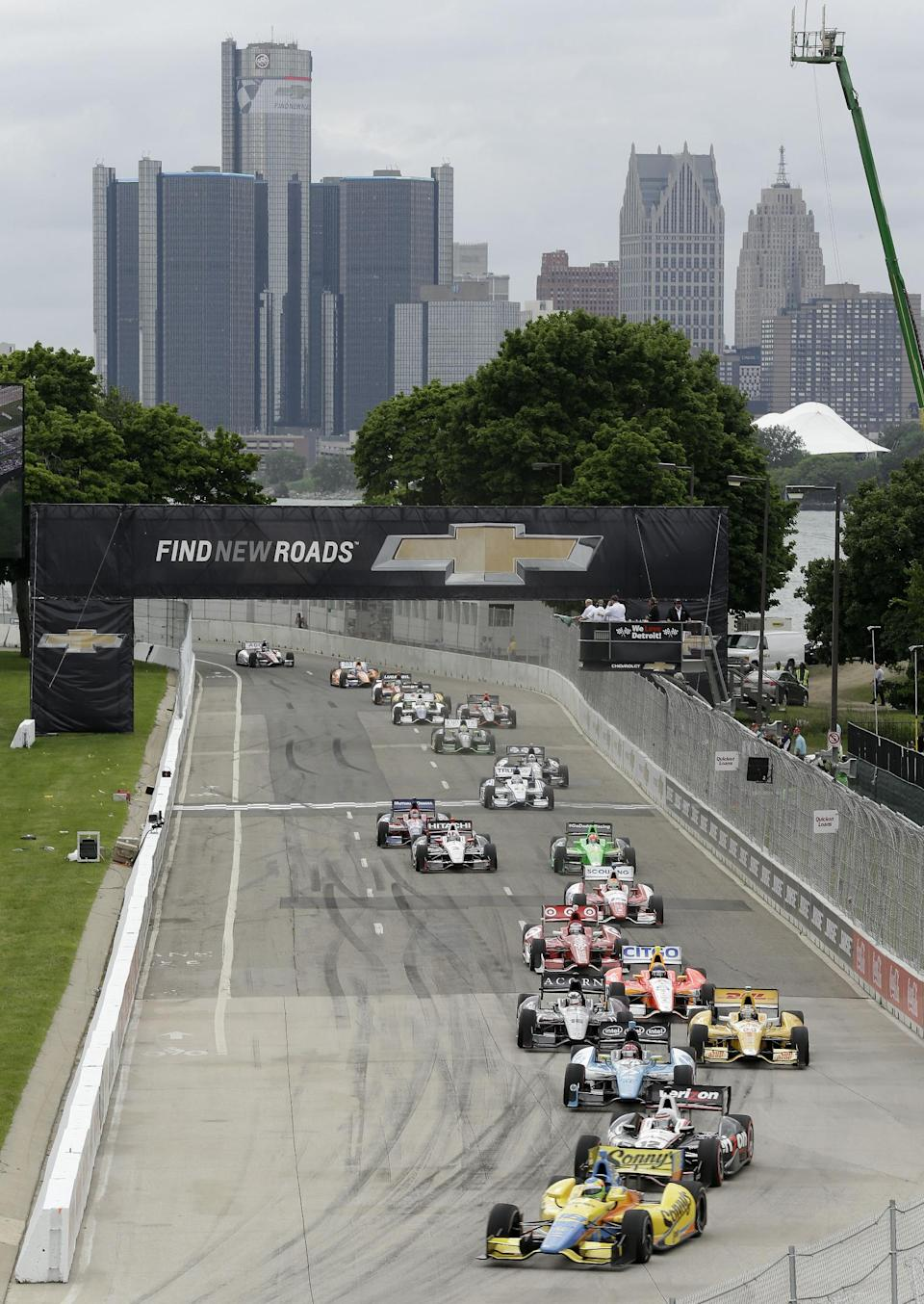 Mike Conway leads the field into turn one during the IndyCar Detroit Grand Prix auto race on Belle Isle in Detroit, Sunday, June 2, 2013. (AP Photo/Paul Sancya)