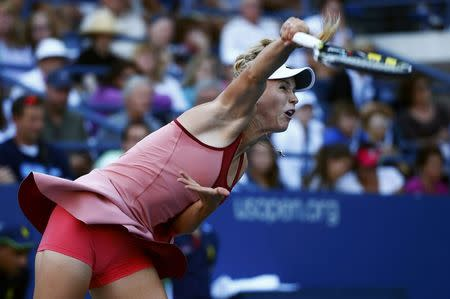 Caroline Wozniacki of Denmark serves to Andrea Petkovic of Germany during their match at the 2014 U.S. Open tennis tournament in New York