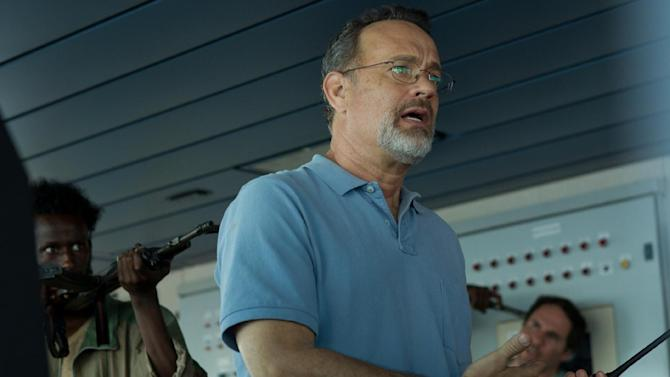 """This photo released by Sony - Columbia Pictures shows actor Tom Hanks in a scene from the film, """"Captain Phillips,"""" releasing in the US on Friday, Oct. 11, 2013. Some amateur actors from Minneapolis made their film debut acting alongside the two-time Academy Award winner, Hanks. The four actors of Somali descent appear as Somali pirates in """"Captain Phillips,"""" which stars Hanks as the captain of a cargo ship hijacked off the Horn of Africa in 2009. (AP Photo/Copyright Sony - Columbia Pictures, Hopper Stone, SMPSP)"""