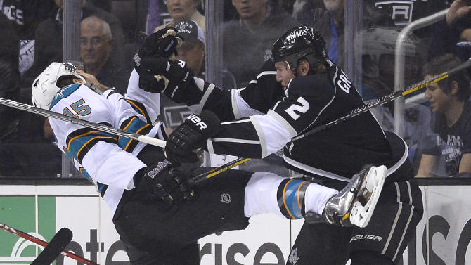 San Jose Sharks center James Sheppard (15) collides with Los Angeles Kings defenseman Matt Greene (2) in the first period during Game 5 of the Western Conference semifinals in the NHL hockey Stanley Cup playoffs, Thursday, May 23, 2013, in Los Angeles. (AP Photo/Mark J. Terrill)