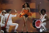 Romania entrant Mandinga perform during rehearsals for the 2012 Eurovision Song Contest at the Baku Crystal Hall in Baku, Monday, May 21, 2012. The final of the 2012 Eurovision Song Contest will be held at the stadium on May 26, 2012. (AP Photo/Sergey Ponomarev)