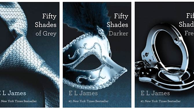 """This combo made of book cover images provided by Vintage Books shows the """"Fifty Shades of Grey"""" trilogy by best-selling author E L James. They're young and old, doctors and churchgoers, gay and straight _ and those are just the MEN who have devoured oh-so-naughty """"Fifty Shades of Grey,"""" a violent, erotic trilogy that has earned millions of women fans in a matter of weeks. (AP Photo/Vintage Books)"""