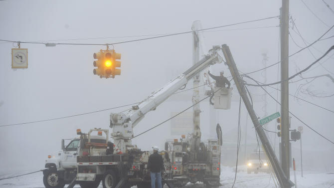 Fog shrouds work crews repairing down power lines Wednesday, Feb. 27, 2013 at 8 mile and Five points, in Southfield, Mich. The storm that hit the nation's midsection dropped at least 7 inches of snow on parts of Michigan and created dangerous driving conditions. (AP Photo/The Detroit News, Daniel Mears) DETROIT FREE PRESS OUT; HUFFINGTON POST OUT