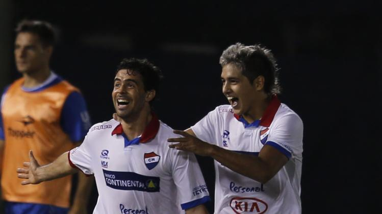 Alfonso Benitez of Nacional celebrates with teammate Torales after scoring a goal against Velez Sarsfield during their Copa Libertadores soccer match in Asuncion