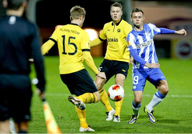 Esbjerg fB's Jakob Ankersen, right, and IF Elfsborg's Andreas Klarstrm, left, and Marcus Rohden during their Europa League group C soccer match in Esbjerg, Denmark, Thursday, Nov. 7 2013