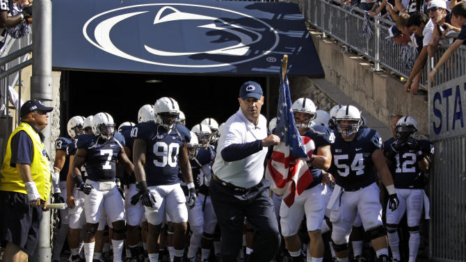Penn State head coach Bill O'Brien leads his team onto the field at Beaver Stadium for an NCAA college football game against Navy in State College, Pa., Saturday, Sept. 15, 2012. (AP Photo/Gene J. Puskar)