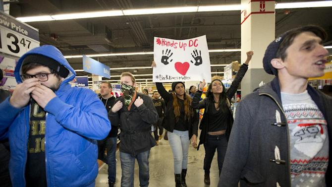 Protesters storm Walmart in Washington, Tuesday, Nov. 25, 2014. A grand jury in Ferguson, Mo., on Monday, Nov. 24th, 2014, declined to indict a white police officer in the shooting death of an unarmed African-American man. (AP Photo/Carolyn Kaster)
