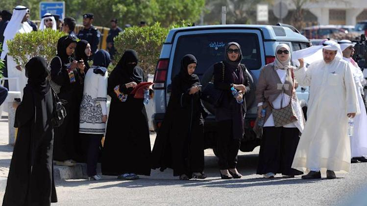 Kuwaiti activists gather outside the courthouse in Kuwait City on November 3, 2011 where two fellow leading youth activists were questioned for allegedly making remarks on their Twitter accounts deemed offensive to the status of the Gulf state ruler