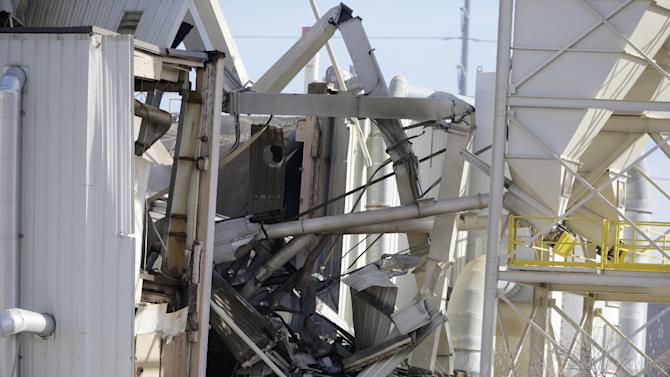 The International Nutrition plant is in wreckage in Omaha, Neb., where a fire and explosion took place Monday, Jan. 20, 2014. At least nine people have been hospitalized and others could be trapped at the animal feed processing plant. (AP Photo/Nati Harnik)