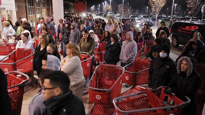 A crowd of shoppers who had not waited in line outside the Target store in Lisbon, Conn., wait by the front doors for the queue to file-in as the store opens for Black Friday shopping at midnight Friday, Nov. 25, 2011.   Black Friday began in earnest as stores opened their doors at midnight.(AP Photo/The Day, Sean D. Elliot)