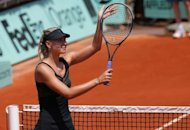 Russia's Maria Sharapova thanks the crowd after beating Romania's Alexandra Cadantu during French Open first round match at Roland Garros in Paris. Sharapova took just 48 minutes to race into the second round on Tuesday with a 6-0, 6-0 humiliation of Cadantu