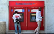 Bank customers use an ATM in California. A US financial industry group warned banks and other institutions to beware of cyber attacks, after some firms reported sporadic problems with their websites