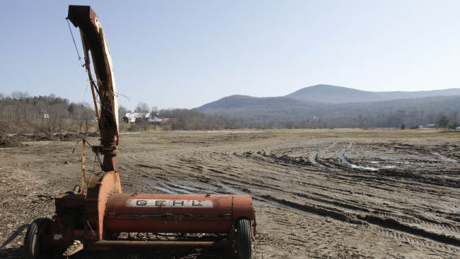 In this March 20, 2012, file photo, silt from Tropical Storm Irene covers a farmers' field Tuesday, March 20, 2012 in Waitsfield, Vt. A year after Hurricane Irene tore through farms from North Carolina to Vermont, some farmers are still grappling with the aftermath. (AP Photo/Toby Talbot)