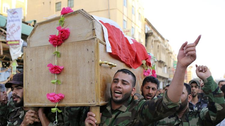 Mourners carry the coffin of a Shi'ite volunteer from the brigades of peace who joined the Iraqi army and was killed during clashes with militants of the Islamic State, during his funeral in Najaf