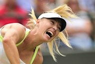 Russia's Maria Sharapova serves during her Wimbledon match against Tsvetana Pironkova on Thursday. Sharapova has backed to plans to silence tennis grunters even though the world number one is one of the worst offenders
