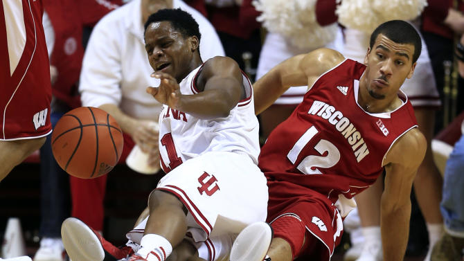 Indiana guard Yogi Ferrell, left, and Wisconsin guard Traevon Jackson go to the court for a loose ball during the first half of an NCAA college basketball game, Tuesday, Jan. 15, 2013, in Bloomington, Ind. (AP Photo/Darron Cummings)