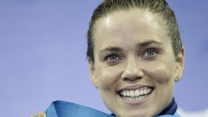 U.S. Natalie Coughlin shows her bronze medal after she won the women's 100m Backstroke event at the FINA Swimming World Championships in Shanghai, China, Tuesday, July 26, 2011. (AP Photo/Michael Sohn)