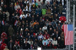 Spectators observe a minute of silence in front of…