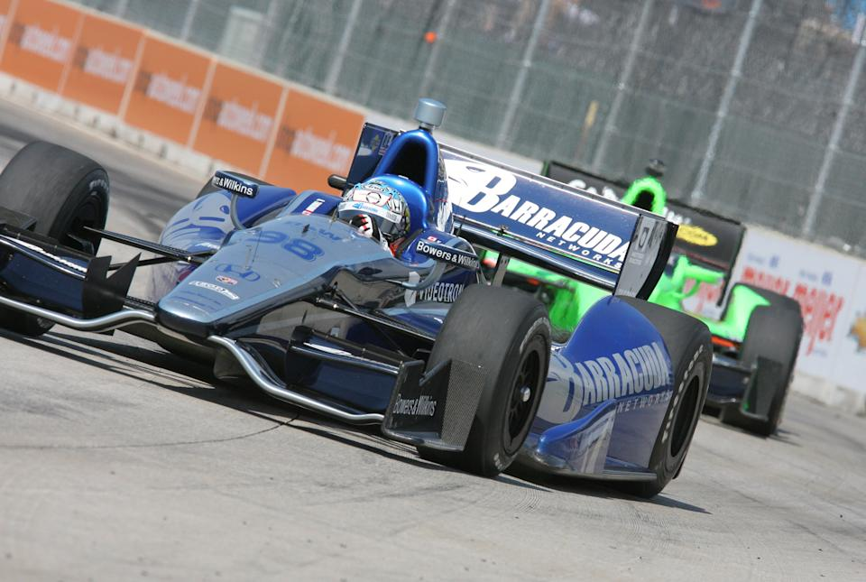 IndyCar driver Alex Tagliani practices on the track for the Detroit Grand Prix auto race on Belle Isle in Detroit, Sunday, June 3, 2012. (AP Photo/Dave Frechette)