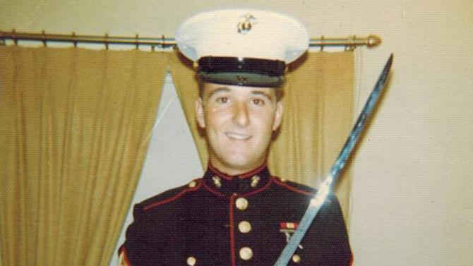 """This undated photo provided by Jody Poirier shows her husband, Ron Poirier in his Marines uniform. Ron Poirier couldn't escape the feeling that his cancer was somehow a punishment. As a young Marine electronics technician at Camp Lejeune in the mid-1970s, the Massachusetts man figured he'd dumped hundreds of gallons of toxic solvents onto the ground. It would be decades before he realized that he had unknowingly contributed to the worst drinking water contamination in the country's history - and, perhaps, to his own premature death. """"It's just a terrible thing,"""" the 58-year-old veteran said shortly before succumbing to esophageal cancer at a Cape Cod nursing facility on May 3, 2013. (AP Photo/Jody Poirier)"""