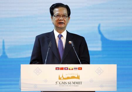 Vietnam's Prime Minister Nguyen Tan Dung speaks during the opening ceremony of the 5th Greater Mekong Subregion (GMS) Summit at a hotel in Bangkok