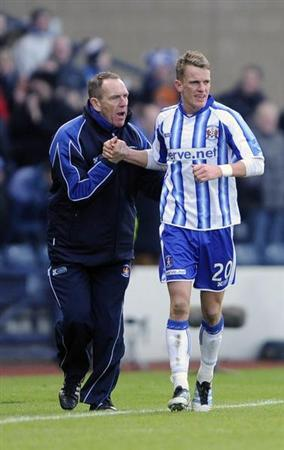 Kilmarnock's Dean Shiels celebrates his goal with Kenny Shiels during their Scottish League Cup semi final soccer match against Ayr United in Hampden Park