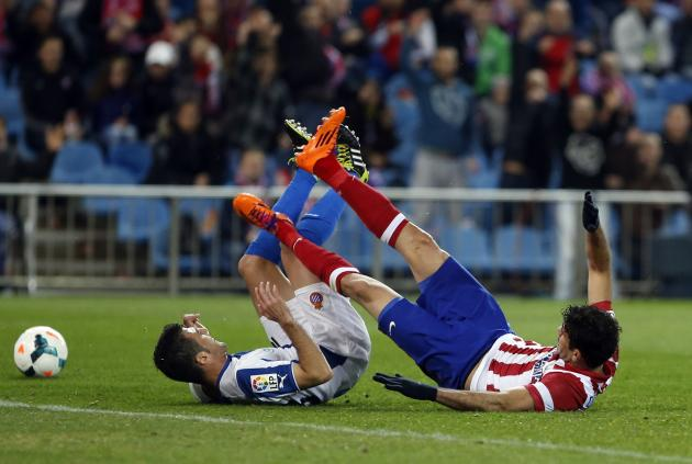 Atletico Madrid's Costa fights for the ball with Espanyol's Fuentes during their Spanish first division soccer match at Vicente Calderon stadium in Madrid,