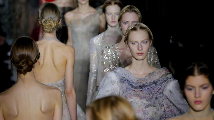 Models wear creations by fashion designers Maria Grazia Chiuri and Pier Paolo Piccioli for Valentino as part of the Women's Spring/Summer 2013 Haute Couture fashion collection presented in Paris, Wednesday, Jan. 23 2013 (AP Photo/ Jacques Brinon)