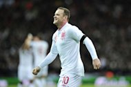 Wayne Rooney, pictured on February 6, 2013, believes it is too soon to talk of the Premier League trophy heading back to Old Trafford