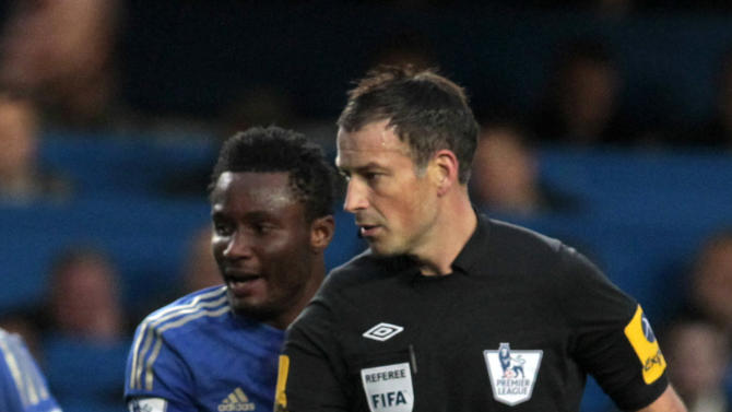 "In this Sunday, Oct. 28, 2012 photo, Chelsea's John Obi Mikel, left, in action, with referee Mark Clattenburg  in the foreground, during the English Premier League soccer match against Manchester United, at Stamford Bridge, London. Chelsea accused referee Mark Clattenburg of using ""inappropriate language"" at two players during Sunday's Premier League match against Manchester United, and lodged an official complaint with the Football Association. Clattenburg sent off two Chelsea players in the 3-2 loss to United at Stamford Bridge and allowed a contentious late winning goal to striker Javier Hernandez, who appeared to be offside when he scored. (AP Photo/Sang Tan)"