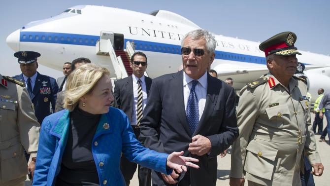 "FILE - In this Wednesday, April 24, 2013 file photo, U.S. Secretary of Defense Chuck Hagel speaks with U.S. Ambassador to Egypt Anne Patterson, left, upon his arrival in Cairo. Egyptian anti-government activists have expressed outrage Friday, June 21, 2013 over a statement by the U.S. ambassador in Cairo in which she criticized street protests as opposition gears up for mass rallies to demand the ouster of President Mohammed Morsi. The ambassador, Anne Patterson, said in a speech earlier this week that she is ""deeply skeptical"" that protests will be fruitful, saying ""more violence on the streets will do little more than add new names to the lists of martyrs."" (AP Photo/Jim Watson, Pool, File)"