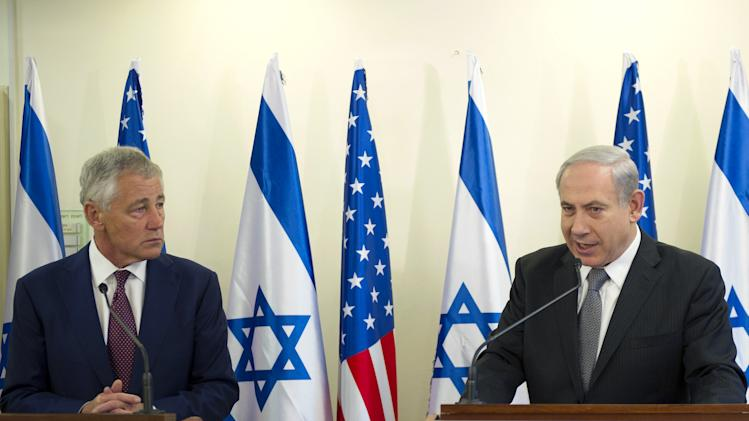 "U.S. Secretary of Defense Chuck Hagel, left, listens at a joint press conference with Israeli Prime Minister Benjamin Netanyahu at the latter's office in Jerusalem, on Tuesday, April 23, 2013.  Hagel said the U.S. and Israel need to ensure that their alliance is ""closer than ever,"" as Mideast security challenges grow more complicated. (AP Photo/Jim Watson, Pool)"