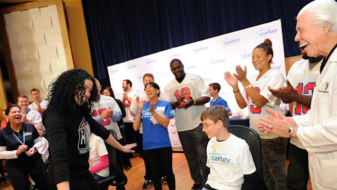 """IMAGE DISTRIBUTED FOR STARKEY HEARING FOUNDATION - American Idol winner Jordin Sparks sings """"Happy Birthday"""" to 14-year-old Garrett Harris, after Bill Austin, founder of Starkey Hearing Foundation fits her with a new hearing aid on Saturday, Feb. 2, 2013 in New Orleans. (Photo by Cheryl Gerber/Invision for Starkey Hearing Foundation/AP Images)"""