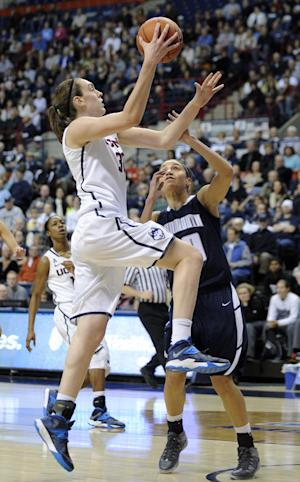 No. 1 UConn women rout Monmouth 100-46