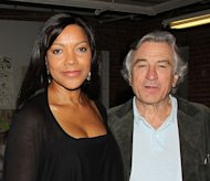 FILE- In this Nov. 17, 2010 file photo released by Starpix, actor Robert Di Niro, stands next to his wife, Grace Hightower. A fire broke out in the actor's apartment, Friday, June 8, 2012 while he was out of the country. It was contained within an hour, and the cause was under investigation. (AP Photo/Starpix, Dave Allocca, File)