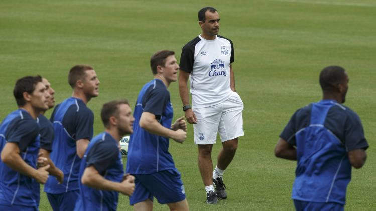 Everton manager Roberto Martinez attends a practice session ahead of Sunday's soccer friendly against Leicester city in Bangkok