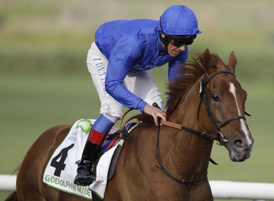 African Story from Great Britain ridden by Lanfranco Dettori, crosses the finish line during the Godolphin Mile race, Saturday, March 31, 2012, in Dubai, United Arab Emirates. (AP Photo/Kamran Jebreili)