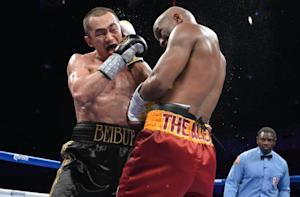 Bernard Hopkins (R) of the US lands a right on Beibut …