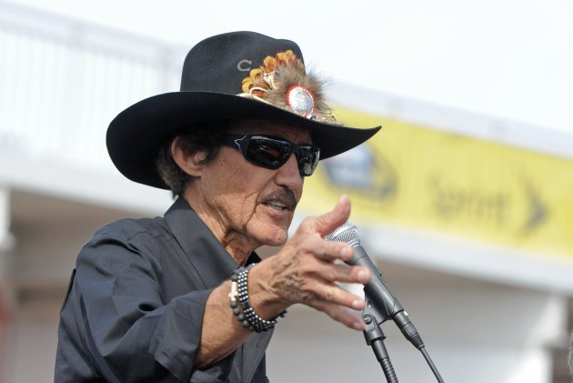 Racing legend Richard Petty speaks at a dedication ceremony for the new Muscle Cars Forever stamps at the Daytona International Speedway